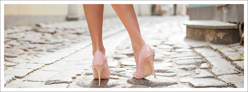 Woman waliking down the street in pink high heels