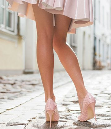 Woman wearing dress with beautiful legs clear of spider or varicose veins