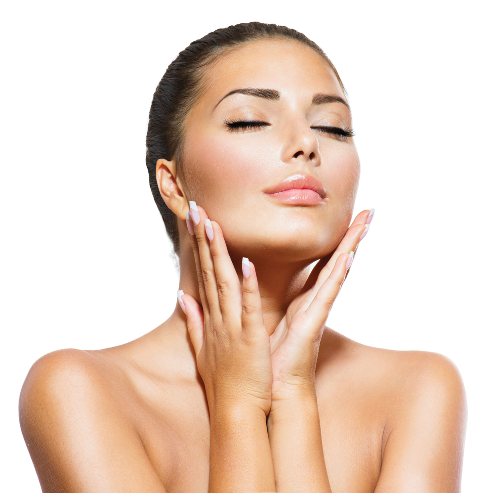 Woman with hands to her face | Get smoother skin with microdermabrasion